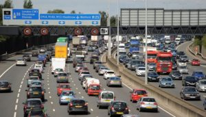 Motorists start to queue in heavy traffic on the M25 between junction 12 and 13 near Egham, Surrey, as the August Bank Holiday getaway begins.
